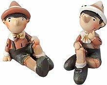 12 Statuetta di Pinocchio seduro 5 x 6 cm