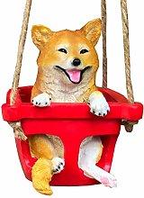 Carino statua del cucciolo oscillante, cucciolo