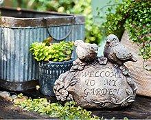 doli decorazioni da giardino
