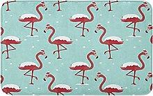 Motivo natalizio con fenicottero in cappello rosso