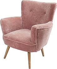 Poltrona in velluto rosa e gambe in legno di