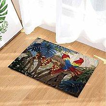 Tappeto da bagno a tema tropicale con foglie verdi