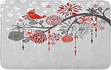 Un ramo invernale con uccello e caduta neve rosso
